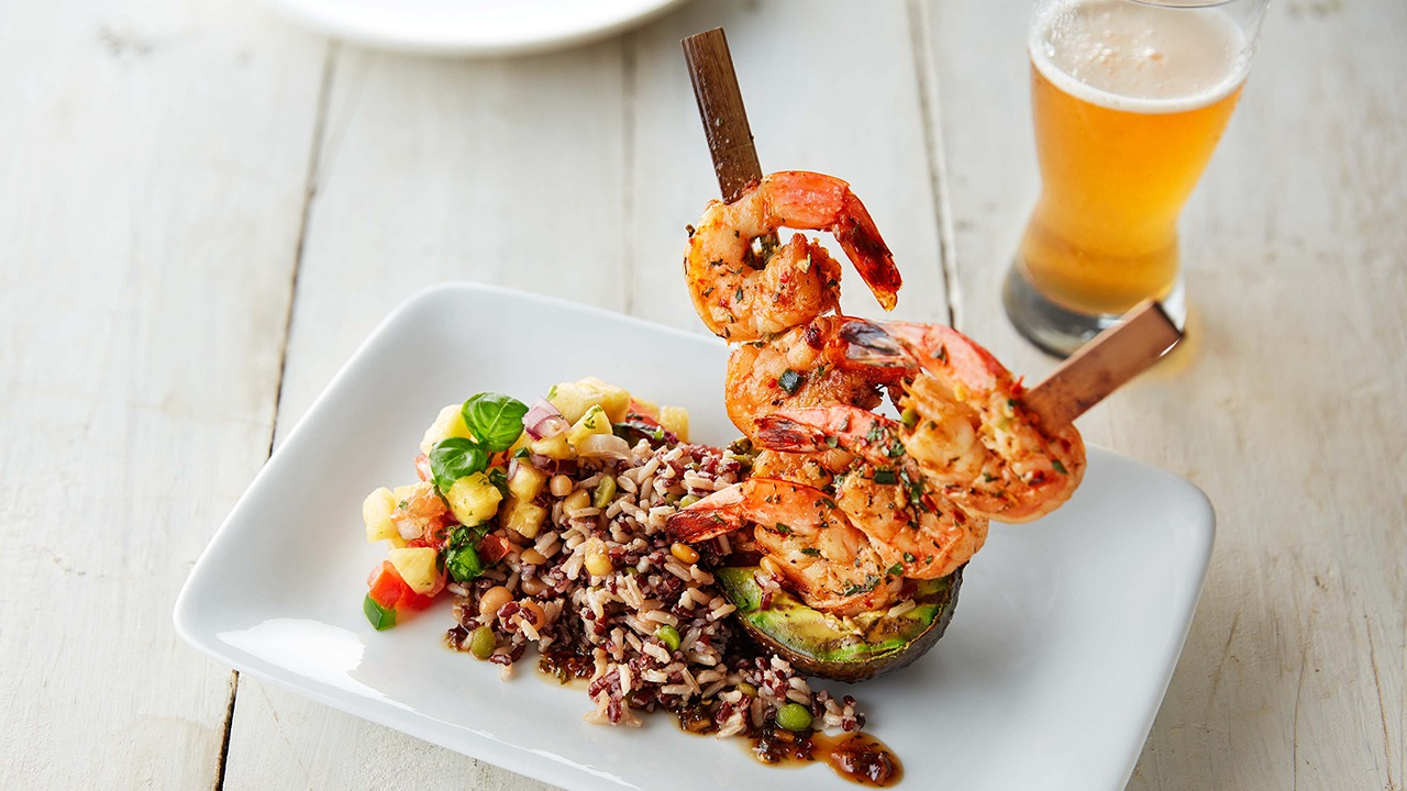 Chile lime shrimp skewers with aztec blend on plate
