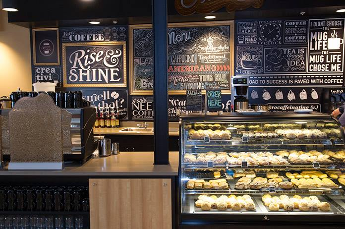 Coffee shop counter with pastries in a display case