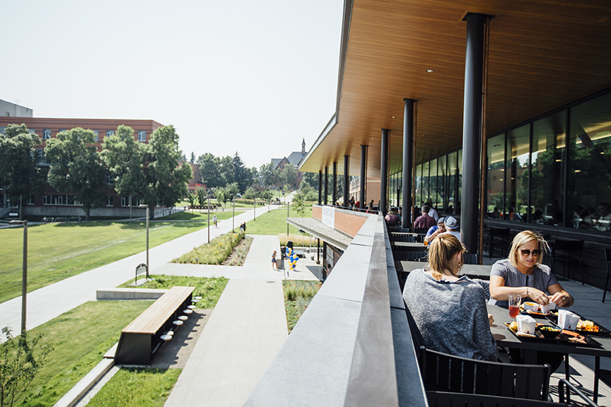 Students enjoying lunch on the patio of Montana State University's new dining pavilion